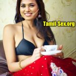 Ramya Pandiyan drinking coffee without blouse in red saree showing her black bra nude cleavage photo